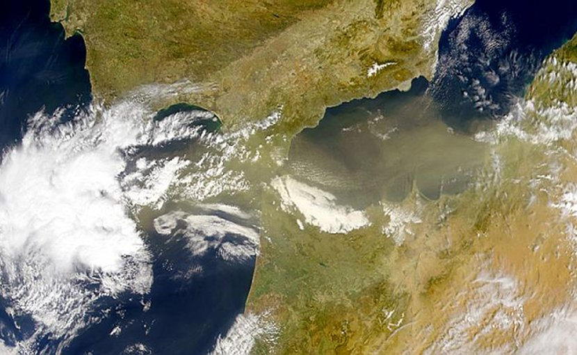Satellite image showing the two most frequent meteorological scenarios where huge amounts of viruses (transported by Atlantic Ocean depressions) and bacteria (transported by Saharan dust intrusions) are deposited in the high mountains of Sierra Nevada and at a global scale. Credit NASA Visible Earth.
