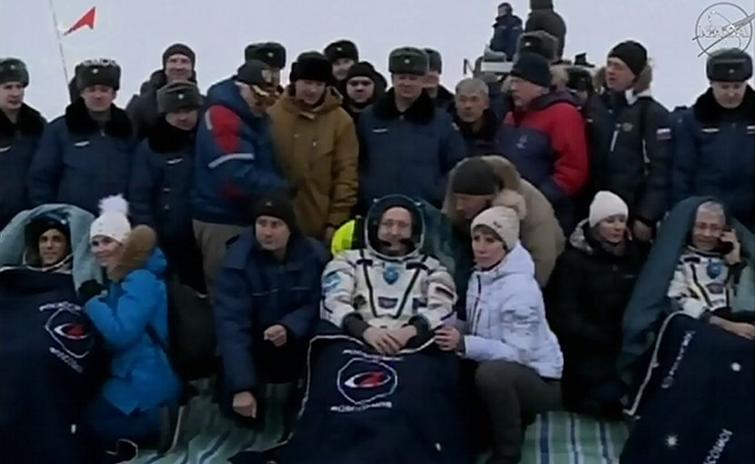 NASA astronaut Joe Acaba, Russian cosmonaut Alexander Misurkin and NASA astronaut Mark Vande Hei relax after their return trip from the International Space Station to their landing site southeast of the remote town of Dzhezkazgan in Kazakhstan, where they touched down at 9:31 p.m. EST Tuesday, Feb. 27, 2018. Credits: NASA Television
