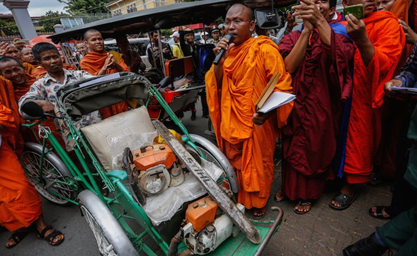 But Buntenh speaks outside the Forestry Administration's headquarters in Phnom Penh last year as monks display chainsaws seized from illegal loggers in the Prey Lang forest. Courtesy: Siv Channa | The Cambodia Daily
