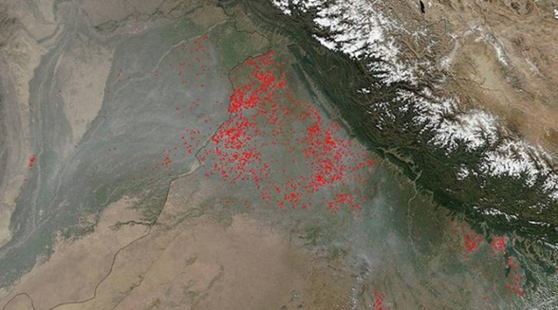This image, captured by NOAA/NASA's Suomi NPP's Visible Infrared Imaging Radiometer Suite (VIIRS), shows agricultural fires in the northernmost section of the Punjab state of India in October 2017. Actively burning areas, detected by VIIRS are outlined in red. Credit NASA/ Jeff Schmaltz, MODIS Rapid Response Team