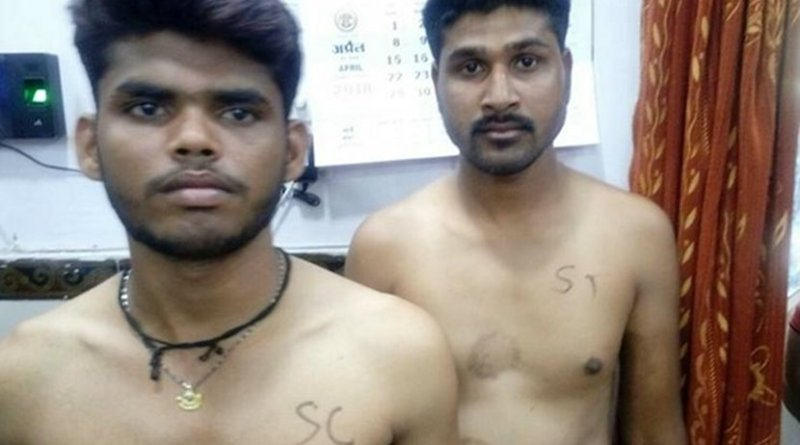 Two young men aspiring to become police constables have their caste identities written on their bare chests in Madhya Pradesh. (Photo by Narendra Teniwal/ucanews.com)