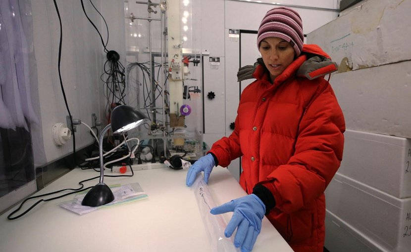 Dr. Monica Arienzo inspects an ice core sample in the ice core lab at the Desert Research Institute in Reno, Nev. Credit DRI