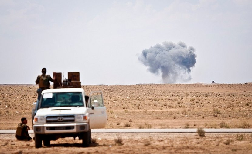 Syrian Democratic Forces watch as a coalition airstrike hits its target on a known Islamic State of Iraq and Syria location near the Iraq-Syria border, May 13, 2018. The SDF forces provided security for a coalition mortar team and were postured to offer quick response force services if needed. The strike was in support of Operation Roundup, the offensive to eliminate pockets of ISIS fighters in the Middle Euphrates River Valley in Syria. DoD photo by Army Staff Sgt. Timothy R. Koster