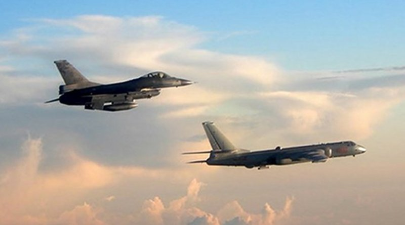 Taiwan's F-16 fighter jet (L) monitors one of two Chinese H-6 bombers that flew over the Bashi Channel south of Taiwan and the Miyako Strait, near Japan's Okinawa Island, in photo taken and released on May 25, 2018 by Taiwan's defense ministry.