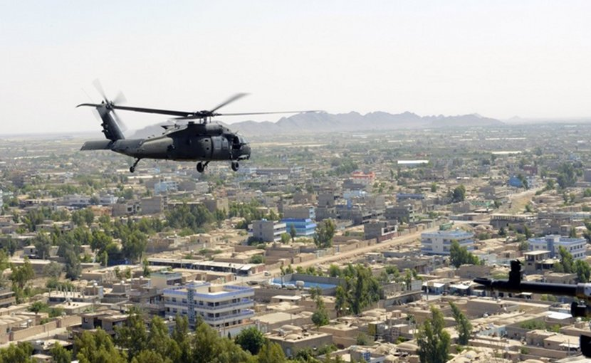 A U.S. Army UH-60 Black Hawk helicopter flies over Farah City, Afghanistan, May 19, 2018. Afghan forces defeated a Taliban offensive to retain control of the city earlier in the week. Air Force photo by Tech. Sgt. Sharida Jackson