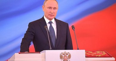 Russia's President Vladimir Putin takes the oath of office on a copy of the Russian Constitution. Photo Credit: Kremlin.ru