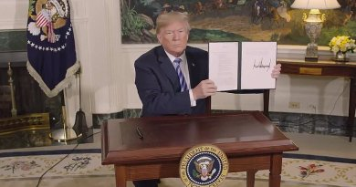 US President Donald Trump signs a Presidential Memorandum on the Iran nuclear deal. Photo Credit: White House video screenshot.