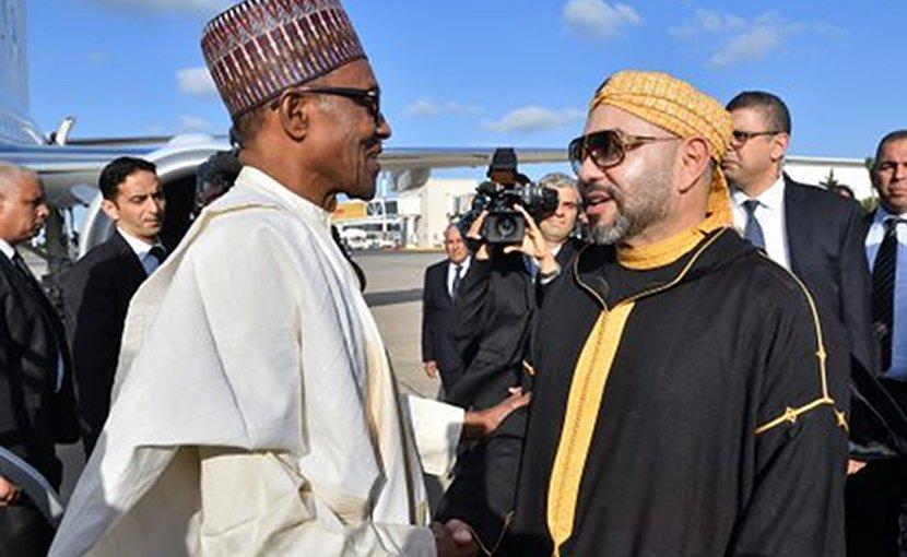 Morocco's King Mohammed VI greets Nigeria's President Muhammadu Buhar.i