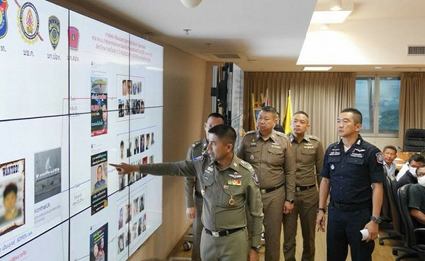 Police Maj. Gen. Surachate Hakpal points at a chart showing Facebook posts while other police officers look on at the computer crimes office in Bangkok, June 12, 2018. Courtesy Royal Thai Police