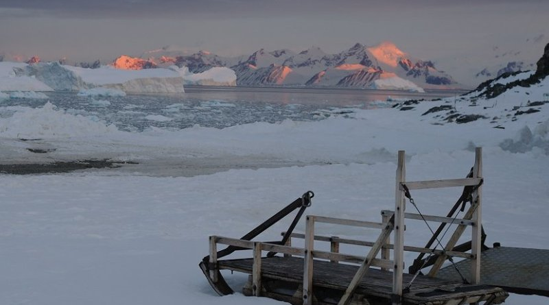 The late summer sun sets over mountains and icebergs around Adelaide Island, Antarctic Peninsula, as 24-hour daylight gives way to the long polar night of winter. Credits: BAS/Hamish Pritchard