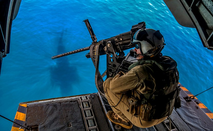 Marine Corps Staff Sgt. Robert Lyvers prepares for landing aboard the USS Iwo Jima in the U.S. 5th Fleet area of operations, June 13, 2018. Lyvers is a CH-53E Super Stallion helicopter crew chief assigned to the 26th Marine Expeditionary Unit. Marine Corps photo by Gunnery Sgt. Eric L. Alabiso II