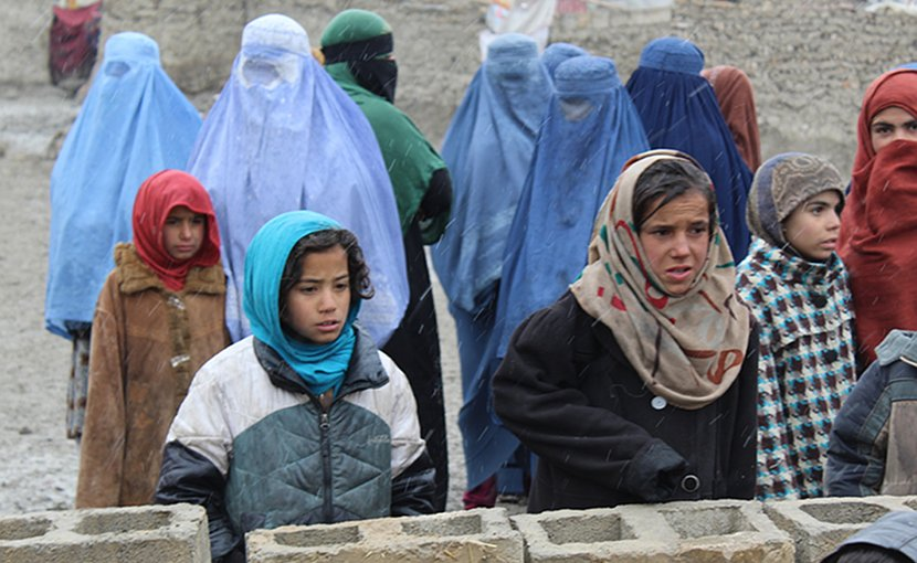 Girls and mothers, waiting for their duvets, in Kabul. Photo Credit: Dr. Hakim