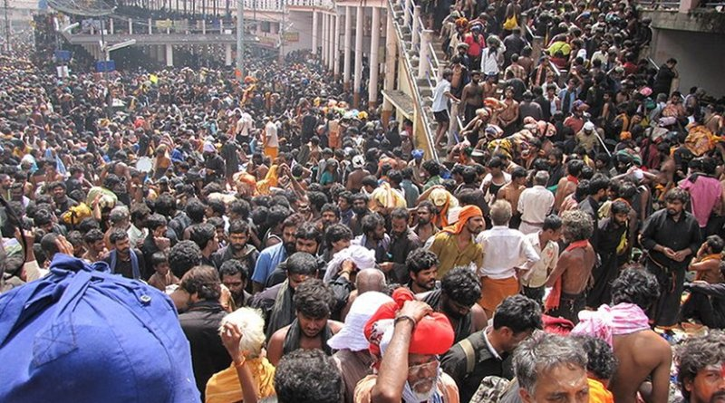 Pilgrims gathering in Sabarimala, India. Photo Credit: Avsnarayan, Wikipedia Commons.