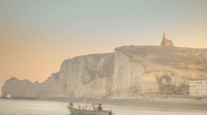 Fishing boat off Dover Cliffs, England.