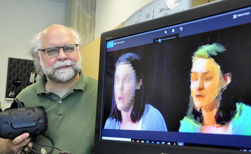 Simon Fraser University professor Steve DiPaola demonstrates his AI method for news-reporting anonymity. Credit SFU