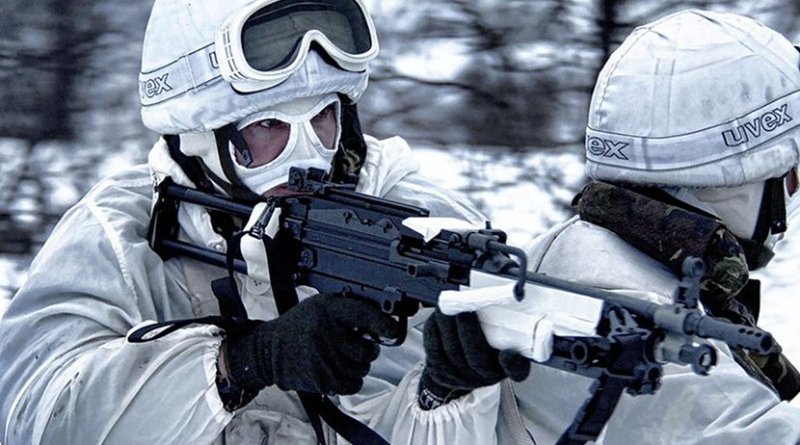 A Royal Marine Commando and member of the Brigade Patrol Troop (BPT) is pictured conducting a live firing exercise in Norway during an exercise. Photo Credit: POA(Phot) Sean Clee, Wikimedia Commons.