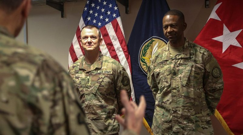 Army Lt. Gen. Paul E. Funk II, outgoing commanding general of Combined Joint Task Force Operation Inherent Resolve, left, and Army Command Sgt. Maj. Michael A. Crosby Jr., stand together while Army Gen. Joseph L. Votel, commander of U.S. Central Command, gives a speech as part of a military decorations ceremony in Baghdad, Sept. 13, 2018. Also at that ceremony, Army Lt. Gen. Paul J. LaCamera, commanding general of the XVIII Airborne Corps, assumed command of the CJTF-OIR from Funk, who is the III Armored Corps commanding general. The III Armored Corps, which deployed from Fort Hood, Texas, to areas in Southwest Asia, transferred its command authority to the XVIII Airborne Corps, deployed from Fort Bragg, North Carolina. CJTF-OIR is a 79-member global coalition that's dedicated to the defeat of the Islamic State of Iraq and Syria. Army photo by Sgt. 1st Class Mikki L. Sprenkle