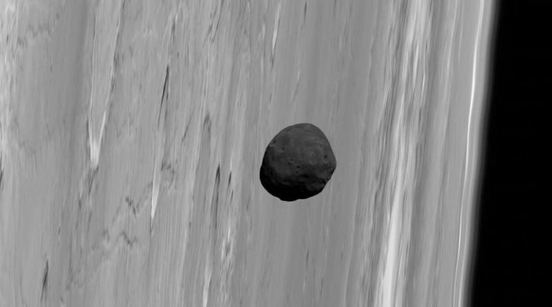 Phobos, the larger of Mars' two tiny satellites, pictured near the limb of Mars by the robot spacecraft Mars Express in 2010. Credit G. Neukum (FU Berlin) et al., Mars Express, DLR, ESA; Acknowledgement: Peter Masek