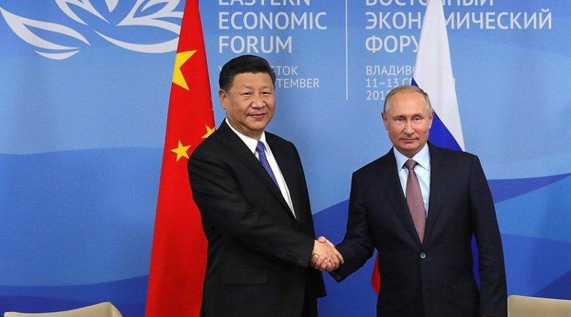 Russia's Vladimir Putin with China's Xi Jinping. Photo Credit: Kremlin.ru