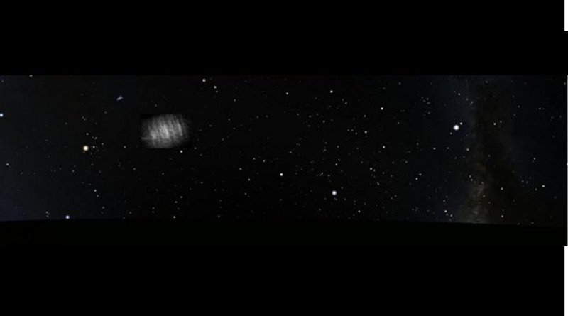 Artist's impression of the Kordylewski cloud in the night sky (with its brightness greatly enhanced) at the time of the observations. Credit G. Horváth