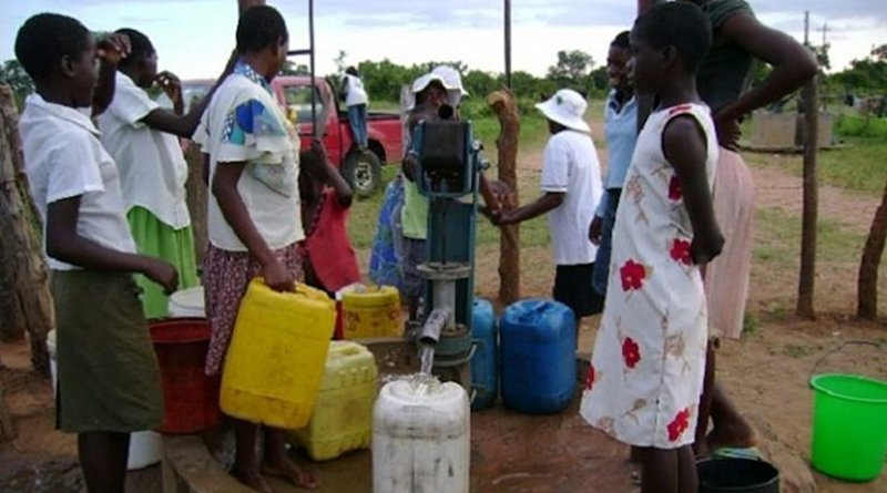 People at a borehole, one of the groundwater sources people have turned to in Zimbabwe's towns and cities as climate change impacts bite. Credit: Construction Review Online.