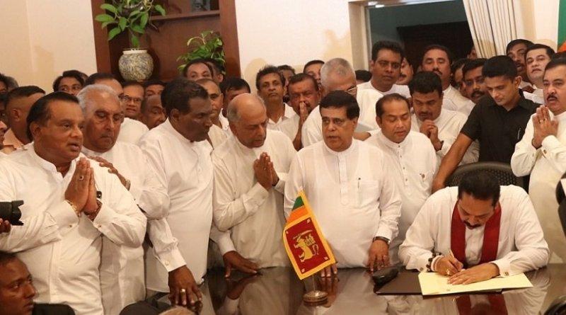 Sri Lanka's Mahinda Rajapaksa assumes duties of Prime Minister. Photo Credit: Sri Lanka government.