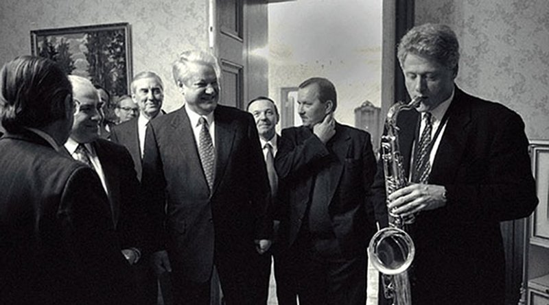 US President Bill Clinton plays the saxophone presented to him by Russian President Boris Yeltsin at a private dinner in Russia. Photo Credit: Bob McNeely, White House, Wikipedia Commons.
