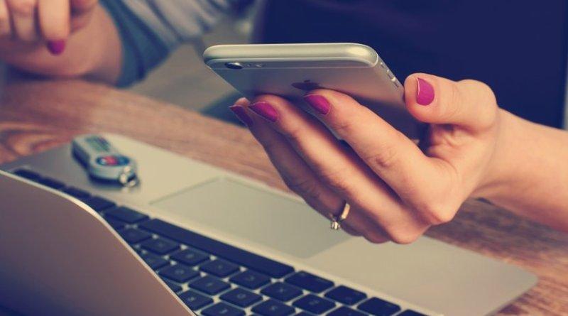 woman business smartphone laptop executive