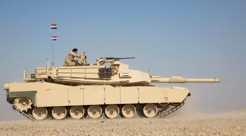 An Iraqi soldier observes a live-fire exercise from atop an M1 Abrams tank at the Besmaya Range Complex in Iraq, Nov. 12, 2018. Army photo by Spc. Eric Cerami
