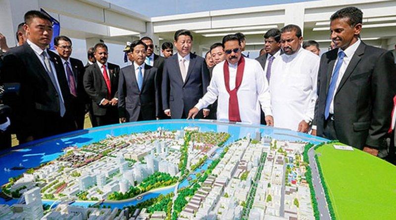 "Sri Lanka President Mahinda Rajapaksa and Chinese President Xi Jinping inspect the model structure of the ""Colombo Port City"". Photo: Mahinda Rajapaksa (CC BY-NC 2.0)."