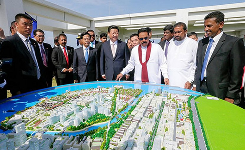 "Sri Lanka President Mahinda Rajapaksa and Chinese President Xi Jinping inspect the model structure of the ""Colombo Port City"". Photo: Mahinda Rajapaksa (CC BY-NC 2.0)."