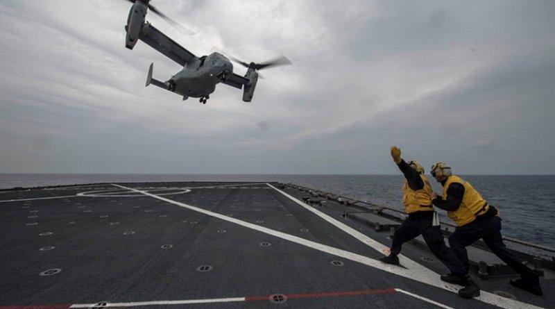 Sailors signal to MV-22 Osprey during flight quarters aboard USS Ashland, East China Sea, March 10, 2017 (U.S. Navy/Kaleb R. Staples)