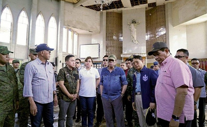 Philippine President Rodrigo Duterte visits the Cathedral of Our Lady of Mount Carmel in Jolo, capital of the southern province of Sulu, Jan. 28, 2019. HO/Office of the President/Courtesy Bong Go