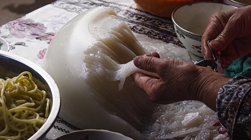 A woman in Kyrgyzstan making soup. Photo by RockMyBike, Flickr