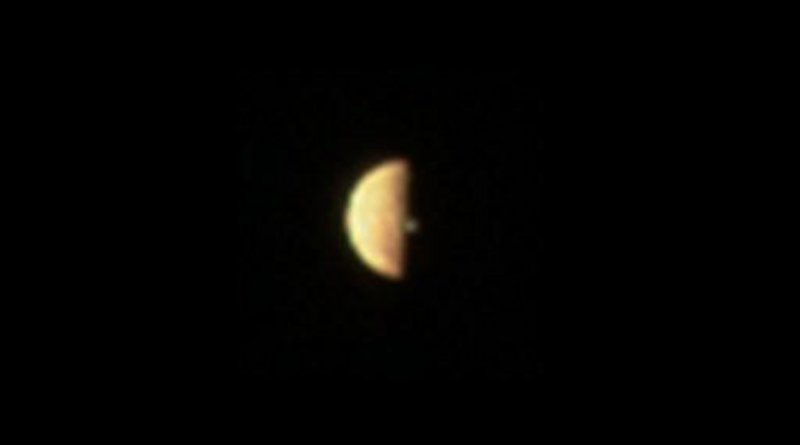 JunoCam acquired three images of Io prior to when it entered eclipse, all showing a volcanic plume illuminated beyond the terminator. The image shown here, reconstructed from red, blue and green filter images, was acquired at 12:20 (UTC) on Dec. 21, 2018. The Juno spacecraft was approximately 300,000 km from Io. Credit NASA/SwRI/MSSS