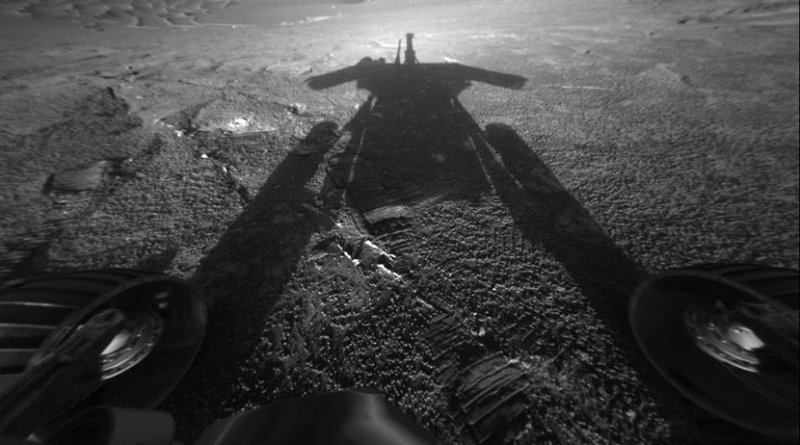 The dramatic image of NASA's Mars Exploration Rover Opportunity's shadow was taken on sol 180 (July 26, 2004) by the rover's front hazard-avoidance camera as the rover moved farther into Endurance Crater in the Meridiani Planum region of Mars. Credits: NASA/JPL-Caltech