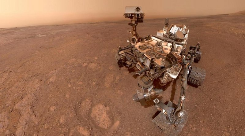 In a selfie taken in mid-January 2019, Mars rover Curiosity prepares to enter a new, clay-mineral-rich unit on its traverse up Mount Sharp in Gale Crater. Mission scientists are anxious to see what a new gravity-measuring technique will reveal about the mountain and Gale Crater's history. Credit NASA/JPL-Caltech/MSSS