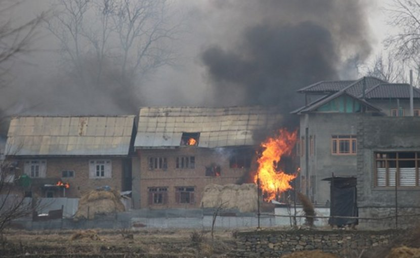 A house burns after security forces set it on fire in Kashmir's Pulwama district to force suspected militants out, Feb 18, 2019. Photo Credit: Sheikh Mashooq/ BenarNews