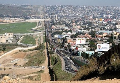 A small fence separates densely-populated Tijuana, Mexico, right, from the United States in the Border Patrol's San Diego Sector. Construction is underway to extend a secondary fence over the top of this hill and eventually to the Pacific Ocean. Source: Wikimedia Commons.