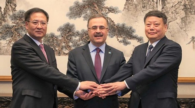 Amin Nasser, center, the president and chief executive of Saudi Aramco, Jiao Kaihe, left, the chairman of NORINCO Group, Tang Yijun, the governor of Liaoning Province, during the signing ceremonies in Beijing, China. (Aramco)