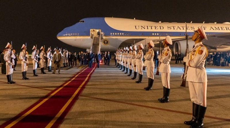 President Donald J. Trump, escorted by Mai Phuoc Dung, Director General of State Protocol of the Socialist Republic of Vietnam, walks along a red carpet from Air Force One and reviews an Honor Cordon upon his arrival Tuesday, Feb. 26, 2019, at Noi Bai International Airport in Hanoi. (Official White House Photo by Shealah Craighead)