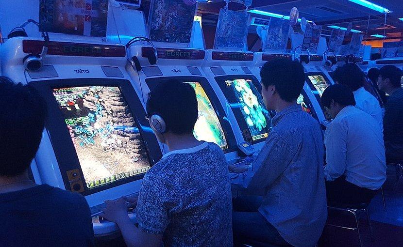Japanese players at a shoot 'em up arcade in Akihabara, Tokyo. Photo Credit: TarkusAB, Wikipedia Commons