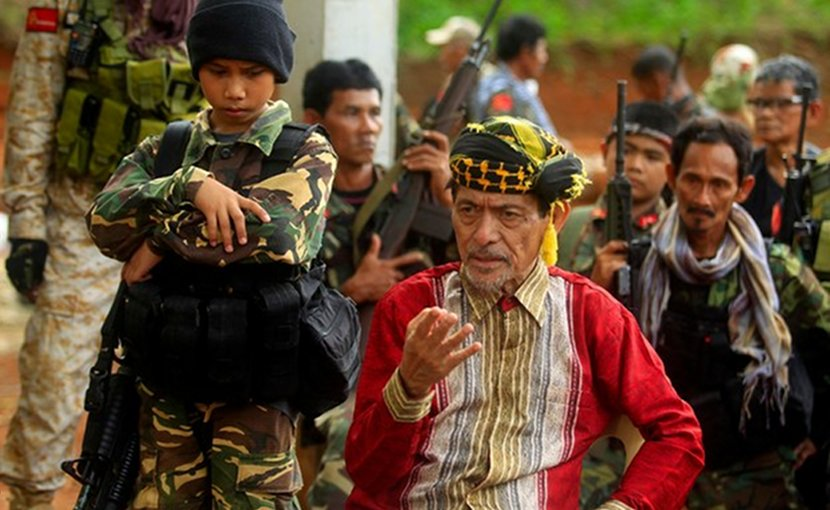 Moro National Liberation Front leader Nur Misuari (center) speaks to reporters while under heavy security in his mountainous base on the southern Philippine island of Jolo, May 29, 2016. Mark Navales/BenarNews