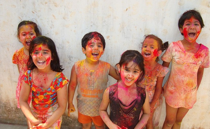 Indian children celebrating Hindu festival of Holi
