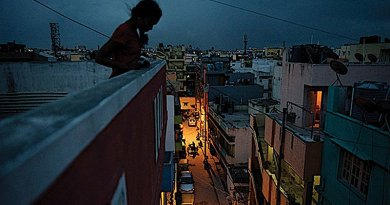 Girl on roof of a factory in India. Source: UNFPA © Andrea Bruce/Noor