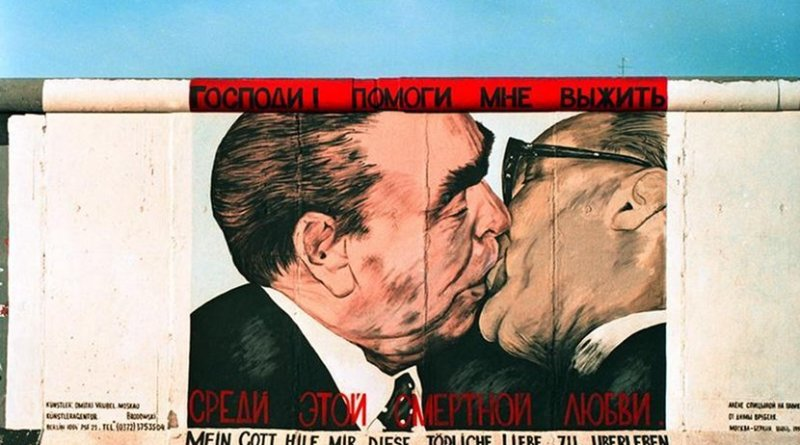 """Graffiti painting from 1990 on the Berlin Wall called """"My God, Help Me to Survive This Deadly Love"""", Photo Credit: Joachim F Thurn, German Federal Archives, Wikimedia Commons"""