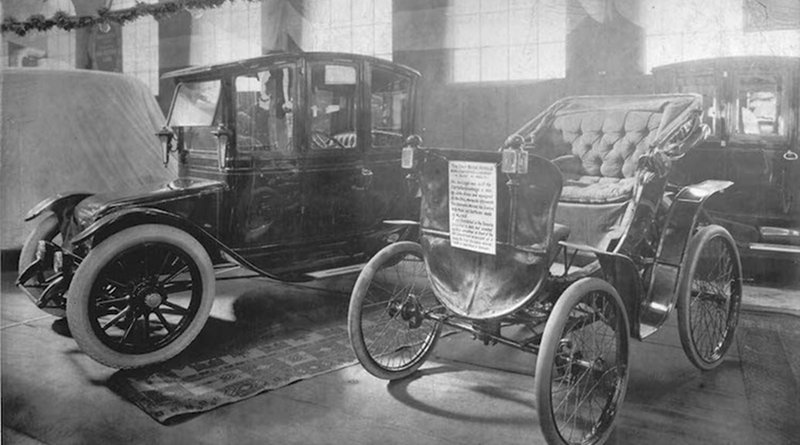 An electric vehicle and an antique car on display at a 1912 auto show in Toronto, Canada. Credit: William James. Source: Wikimedia Commons.