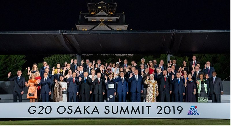 President Donald J. Trump participates in a group photo during G20 Cultural Program at the Osaka Geihinkan with fellow leaders attending G20 Japan Summit Friday, June 28, 2019, in Osaka, Japan. (Official White House Photo by Tia Dufour)