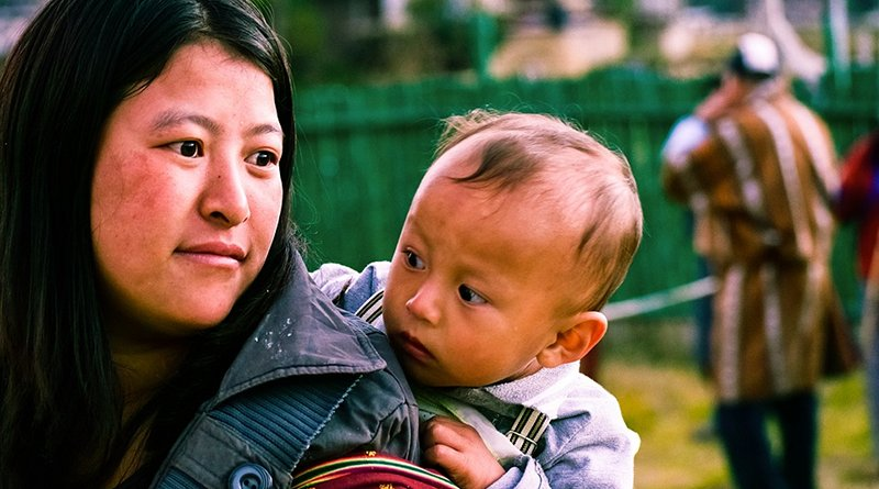 Woman with child in Bhutan