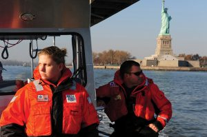 U.S. Coast Guard petty officers conducting a pollution assessment in the wake of Hurricane Sandy, 11 November 2012